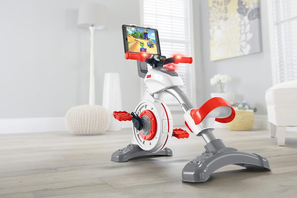 Velo Appartement Pour Enfant fisher-price présente un vélo d'appartement connecté pour