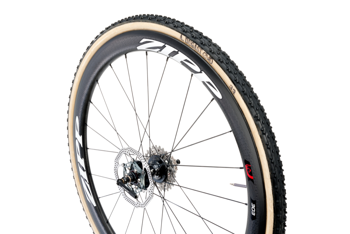 _Zipp_Road_303_Disc_T_Rear_White_wTire_Hero2